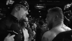(Let's not forget that this feud started way back at UFC 121, when Taker awkwardly confronted Lesnar after he got his ass kicked for REAL at the hands of Cain Velasquez.)